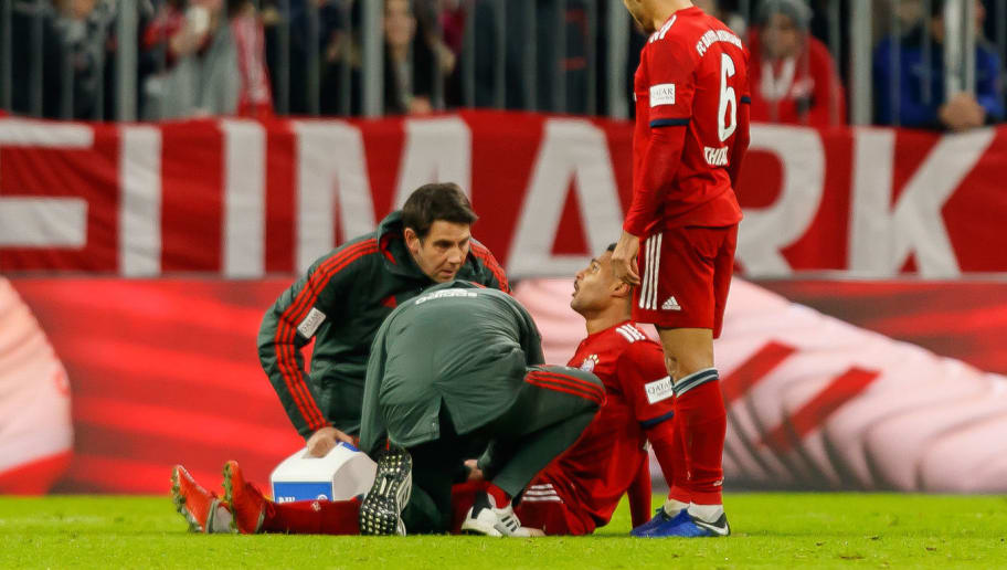MUNICH, GERMANY - DECEMBER 19: Serge Gnabry of FC Bayern Muenchen injured on the ground during the Bundesliga match between FC Bayern Muenchen and RB Leipzig at Allianz Arena on December 19, 2018 in Munich, Germany. (Photo by TF-Images/TF-Images via Getty Images)
