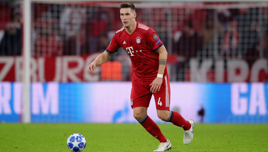 MUNICH, GERMANY - NOVEMBER 27:  Niklas Suele of FC Bayern Muenchen runs with the ball during the Group E match of the UEFA Champions League between FC Bayern Muenchen and SL Benfica at Allianz Arena on November 27, 2018 in Munich, Germany.  (Photo by Alexander Hassenstein/Bongarts/Getty Images)