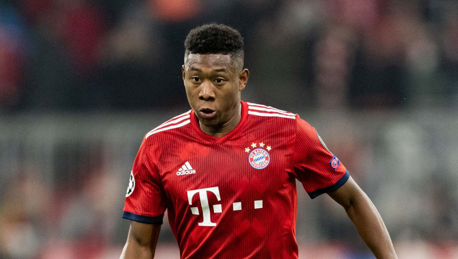 MUNICH, GERMANY - NOVEMBER 27: David Alaba of FC Bayern Muenchen runs with the ball during the Group E match of the UEFA Champions League between FC Bayern Muenchen and SL Benfica at Allianz Arena on November 27, 2018 in Munich, Germany. (Photo by Boris Streubel/Getty Images)