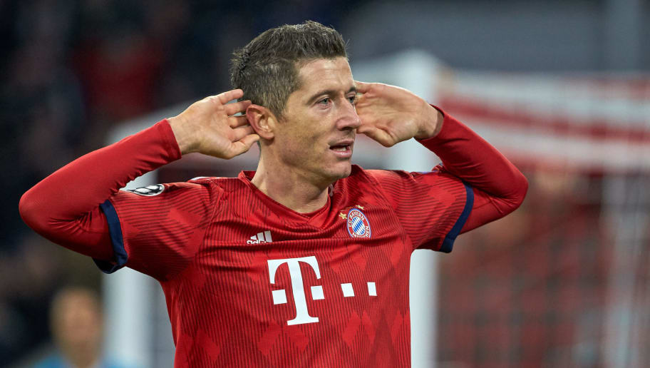 MUNICH, GERMANY - NOVEMBER 27: Robert Lewandowski of Bayern Muenchen celebrates after scoring his team's third goal during the Group E match of the UEFA Champions League between FC Bayern Muenchen and SL Benfica at Allianz Arena on November 27, 2018 in Munich, Germany. (Photo by TF-Images/Getty Images)