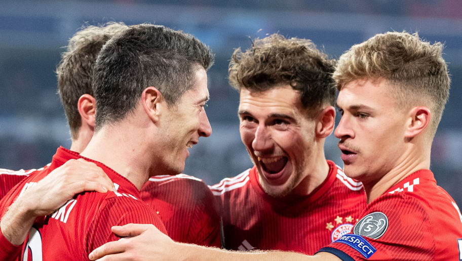 MUNICH, GERMANY - NOVEMBER 27: Robert Lewandowski of FC Bayern Muenchen celebrates with team mates after scoring his team's fourth goal during the Group E match of the UEFA Champions League between FC Bayern Muenchen and SL Benfica at Allianz Arena on November 27, 2018 in Munich, Germany. (Photo by Boris Streubel/Getty Images)