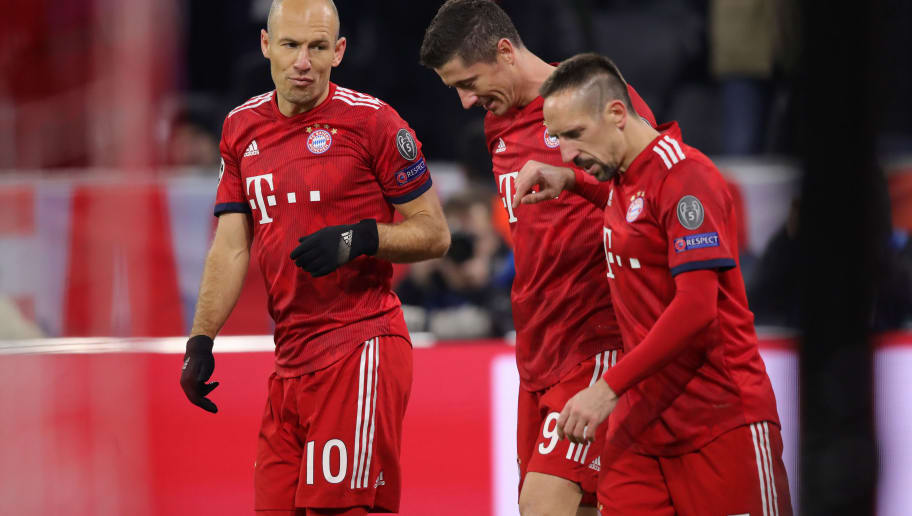 MUNICH, GERMANY - NOVEMBER 27:  Robert Lewandowski of Bayern Munich (C) celebrates after scoring his team's fourth goal with team mates Arjen Robben (10) and Franck Ribery (7) during the UEFA Champions League Group E match between FC Bayern Muenchen and SL Benfica at Fussball Arena Muenchen on November 27, 2018 in Munich, Germany.  (Photo by Alex Hassenstein/Getty Images)