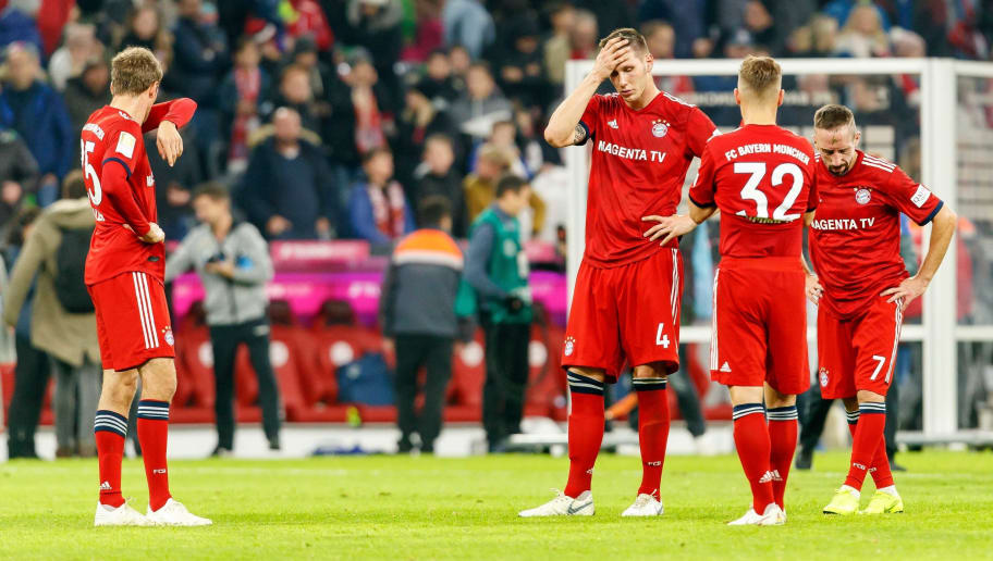 MUNICH, GERMANY - NOVEMBER 03: Thomas Mueller of Bayern Muenchen, Niklas Suele of Bayern Muenchen, Joshua Kimmich of Bayern Muenchen, Franck Ribery of Bayern Muenchen look dejected after the Bundesliga match between FC Bayern Muenchen and Sport-Club Freiburg at Allianz Arena on November 3, 2018 in Munich, Germany. (Photo by TF-Images/Getty Images)