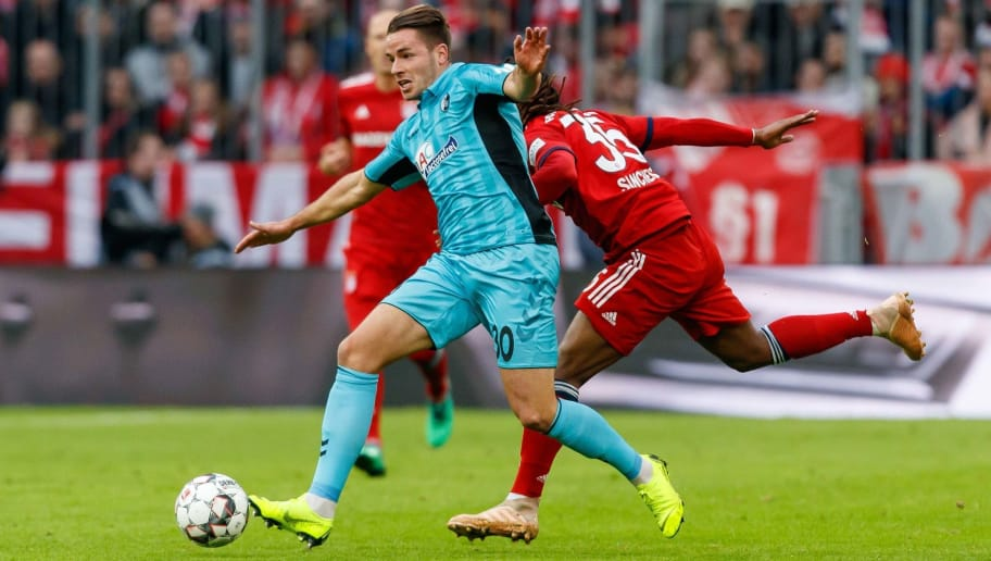 MUNICH, GERMANY - NOVEMBER 03: Christian Guenter of Sport-Club Freiburg and Renato Sanches of Bayern Muenchen battle for the ball during the Bundesliga match between FC Bayern Muenchen and Sport-Club Freiburg at Allianz Arena on November 3, 2018 in Munich, Germany. (Photo by TF-Images/Getty Images)