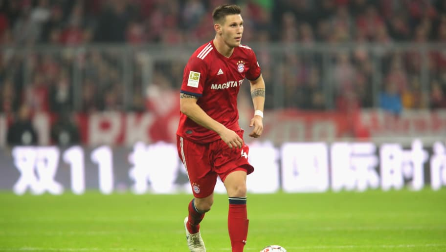 MUNICH, GERMANY - NOVEMBER 03:  Niklas Suele of Bayern Muenchen runs with the ball during the Bundesliga match between FC Bayern Muenchen and Sport-Club Freiburg at Allianz Arena on November 3, 2018 in Munich, Germany.  (Photo by Alexander Hassenstein/Bongarts/Getty Images)