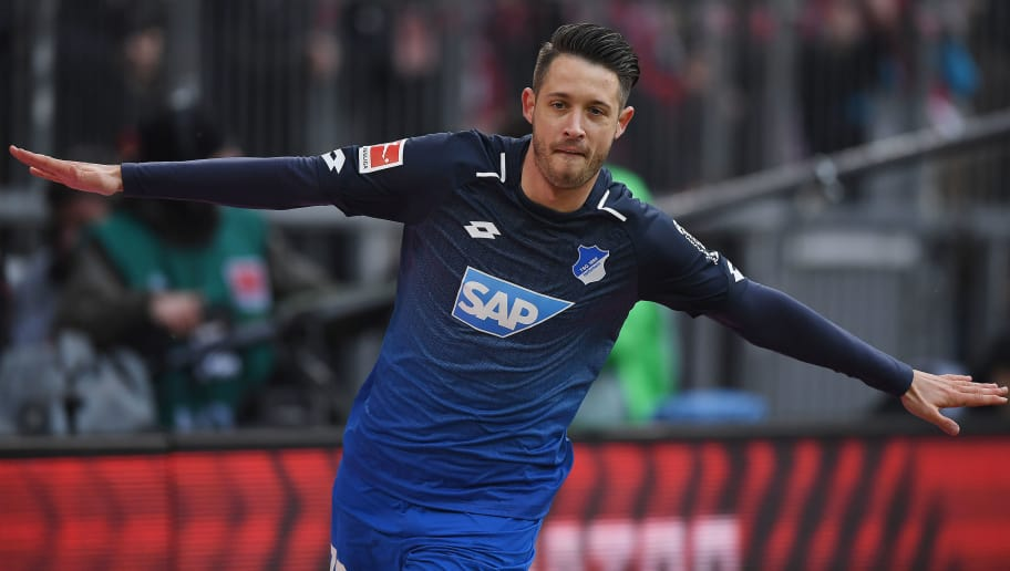 MUNICH, GERMANY - JANUARY 27: Mark Uth of Hoffenheim celebrates after he scored a goal to make it 0:1 during the Bundesliga match between FC Bayern Muenchen and TSG 1899 Hoffenheim at Allianz Arena on January 27, 2018 in Munich, Germany. (Photo by Matthias Hangst/Bongarts/Getty Images)