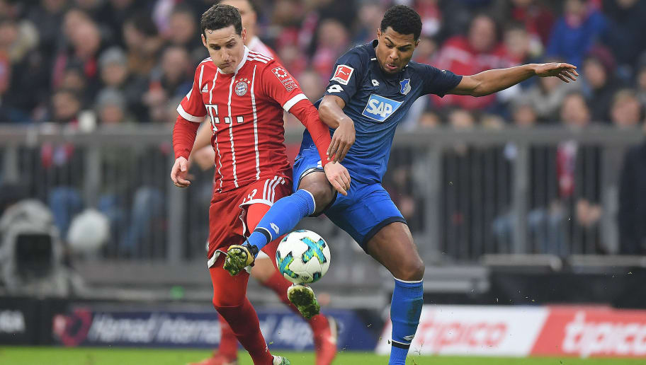 MUNICH, GERMANY - JANUARY 27: Sebastian Rudy of Bayern Muenchen (l) fights for the ball with Serge Gnabry of Hoffenheim during the Bundesliga match between FC Bayern Muenchen and TSG 1899 Hoffenheim at Allianz Arena on January 27, 2018 in Munich, Germany. (Photo by Matthias Hangst/Bongarts/Getty Images)