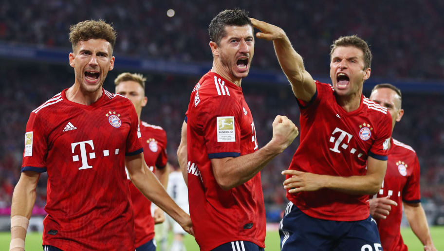 MUNICH, GERMANY - AUGUST 24:  Robert Lewandowski of Bayern Munich (C) celebrates after scoring his team's second goal from a penalty with Leon Goretzka and Thomas Mueller during the Bundesliga match between FC Bayern Muenchen and TSG 1899 Hoffenheim at Allianz Arena on August 24, 2018 in Munich, Germany.  (Photo by Lars Baron/Bongarts/Getty Images)