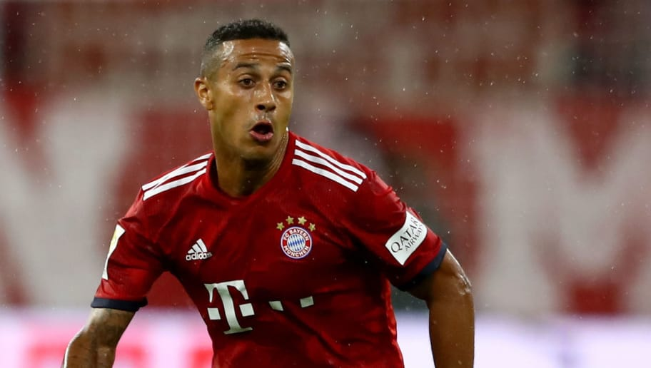 MUNICH, GERMANY - AUGUST 24:  Thiago of Muenchen runs with the ball during the Bundesliga match between FC Bayern Muenchen and TSG 1899 Hoffenheim at Allianz Arena on August 24, 2018 in Munich, Germany.  (Photo by Martin Rose/Bongarts/Getty Images)