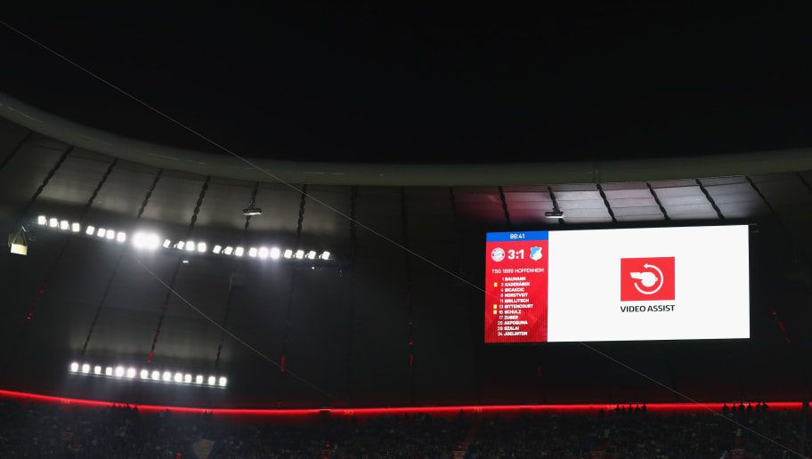 MUNICH, GERMANY - AUGUST 24:  A VAR review is displayed on the scoreboard during the Bundesliga match between FC Bayern Muenchen and TSG 1899 Hoffenheim at Allianz Arena on August 24, 2018 in Munich, Germany.  (Photo by Lars Baron/Bongarts/Getty Images)