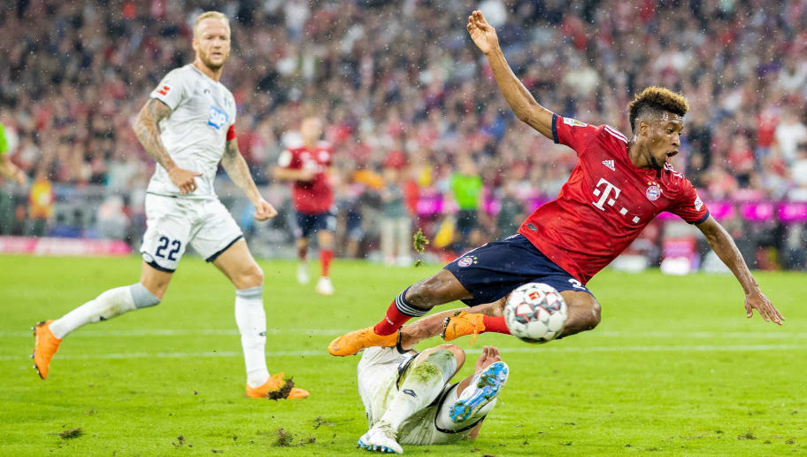 MUNICH, GERMANY - AUGUST 24: Kingsley Coman of FC Bayern Muenchen is tackled by Ermin Bicakcic of TSG Hoffenheim during the Bundesliga match between FC Bayern Muenchen and TSG 1899 Hoffenheim at Allianz Arena on August 24, 2018 in Munich, Germany. (Photo by Boris Streubel/Getty Images)