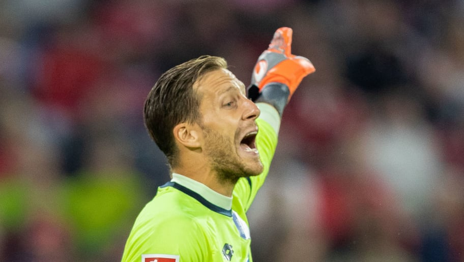 MUNICH, GERMANY - AUGUST 24: Goalkeeper Oliver Baumann of TSG Hoffenheim gestures during the Bundesliga match between FC Bayern Muenchen and TSG 1899 Hoffenheim at Allianz Arena on August 24, 2018 in Munich, Germany. (Photo by Boris Streubel/Getty Images)