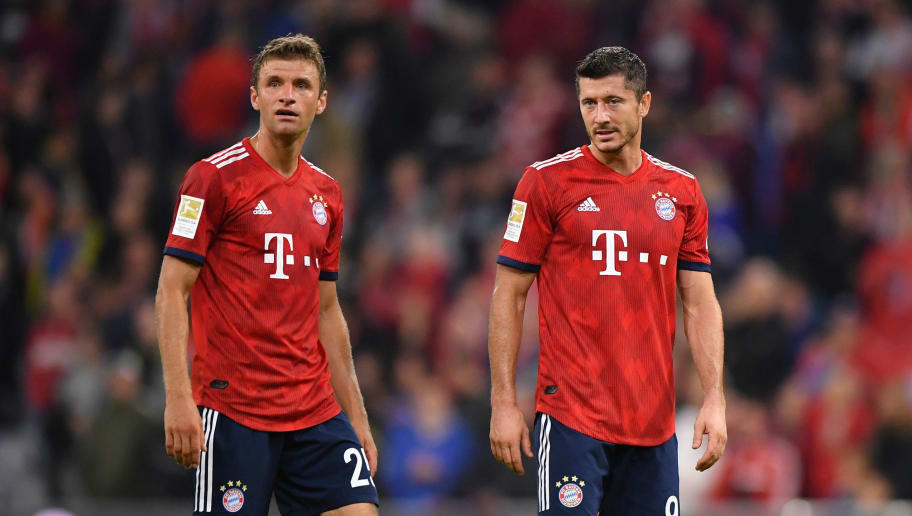 MUNICH, GERMANY - AUGUST 24: Thomas Mueller (l) and Robert Lewandowski of Bayern Muenchen look on during the Bundesliga match between FC Bayern Muenchen and TSG 1899 Hoffenheim at Allianz Arena on August 24, 2018 in Munich, Germany. (Photo by Sebastian Widmann/Bongarts/Getty Images)
