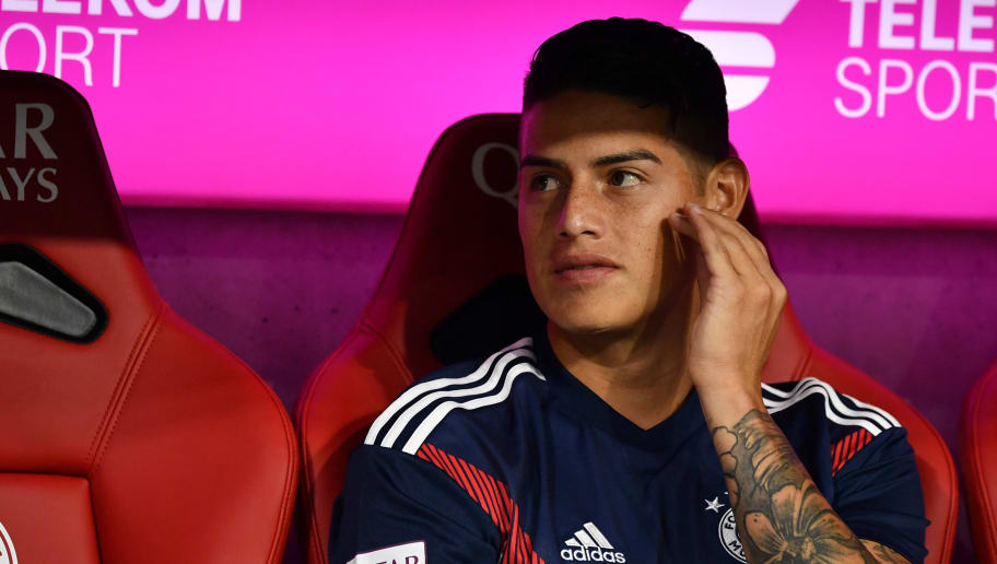MUNICH, GERMANY - AUGUST 24: James Rodriguez of Bayern Muenchen sits on the bench during the Bundesliga match between FC Bayern Muenchen and TSG 1899 Hoffenheim at Allianz Arena on August 24, 2018 in Munich, Germany. (Photo by Sebastian Widmann/Bongarts/Getty Images)