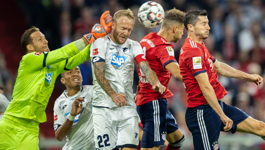 MUNICH, GERMANY - AUGUST 24: Goalkeeper Oliver Baumann of TSG Hoffenheim saves the ball during the Bundesliga match between FC Bayern Muenchen and TSG 1899 Hoffenheim at Allianz Arena on August 24, 2018 in Munich, Germany. (Photo by Boris Streubel/Getty Images)