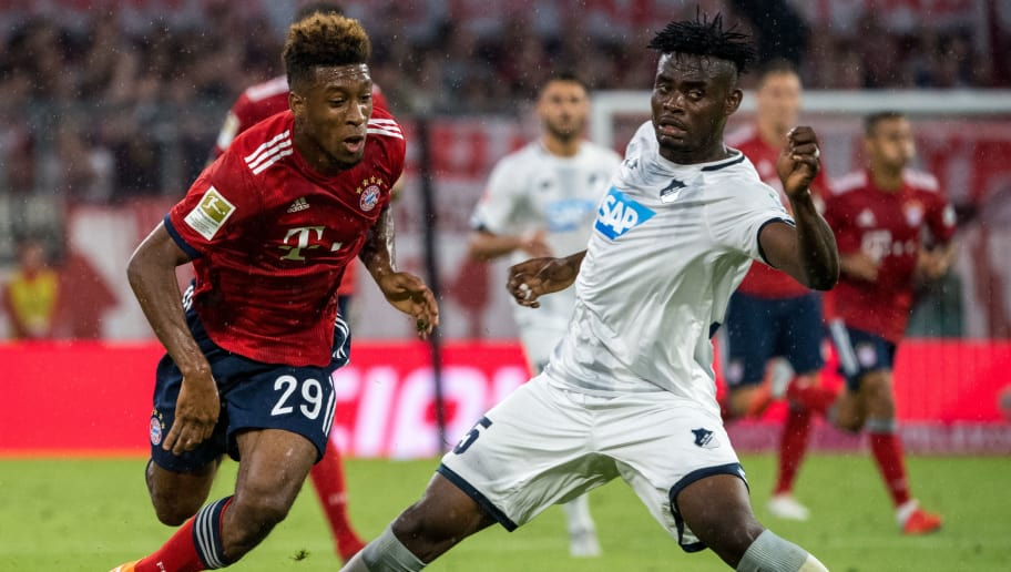 MUNICH, GERMANY - AUGUST 24: Kingsley Koman (L) from Munich and Kasmin Adams from Hoffenheim during the Bundesliga match between FC Bayern Muenchen and TSG 1899 Hoffenheim at Allianz Arena on August 24, 2018 in Munich, Germany. (Photo by Marc Mueller/Getty Images )
