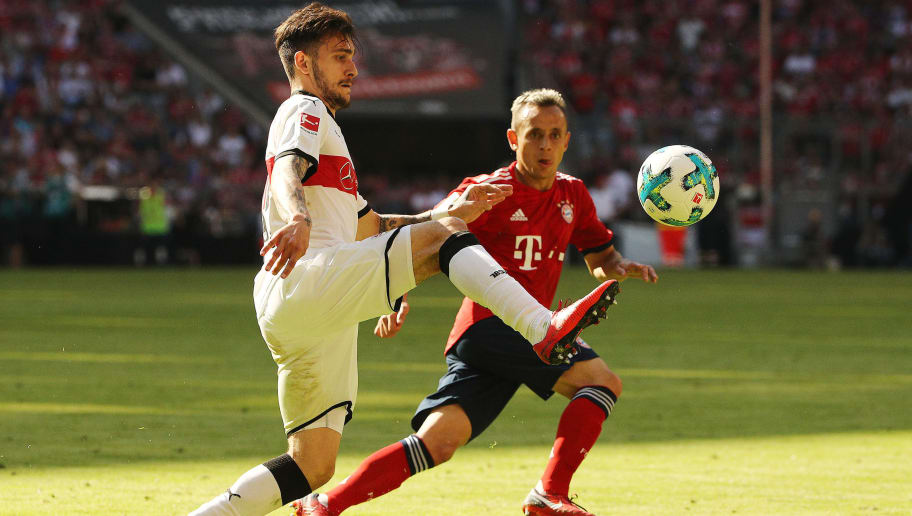 MUNICH, GERMANY - MAY 12: Anastasios Donis of Stuttgart (l) fights for the ball with Rafinha of Bayern Muenchen during the Bundesliga match between FC Bayern Muenchen and VfB Stuttgart at Allianz Arena on May 12, 2018 in Munich, Germany. (Photo by Adam Pretty/Bongarts/Getty Images)