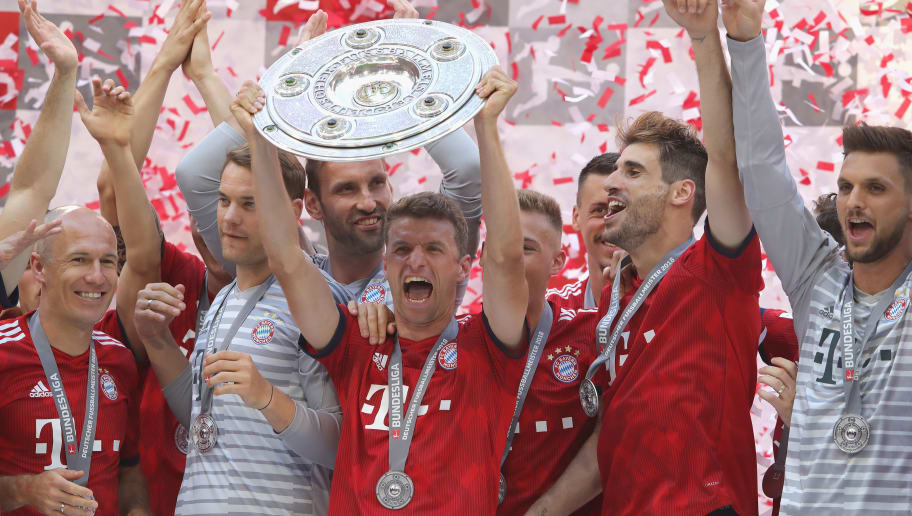 MUNICH, GERMANY - MAY 12:  Thomas Mueller of Bayern Muenchen lifts the trophy in Celebration for winning the German Champiosnhip title after the Bundesliga match between FC Bayern Muenchen and VfB Stuttgart at Allianz Arena on May 12, 2018 in Munich, Germany.  (Photo by Alexander Hassenstein/Bongarts/Getty Images)
