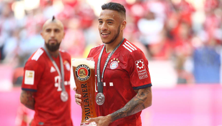 MUNICH, GERMANY - MAY 12: Tolisso of Bayern Muenchen is seen with a glas of bear during the Bundesliga match between FC Bayern Muenchen and VfB Stuttgart at Allianz Arena on May 12, 2018 in Munich, Germany. (Photo by Adam Pretty/Bongarts/Getty Images)
