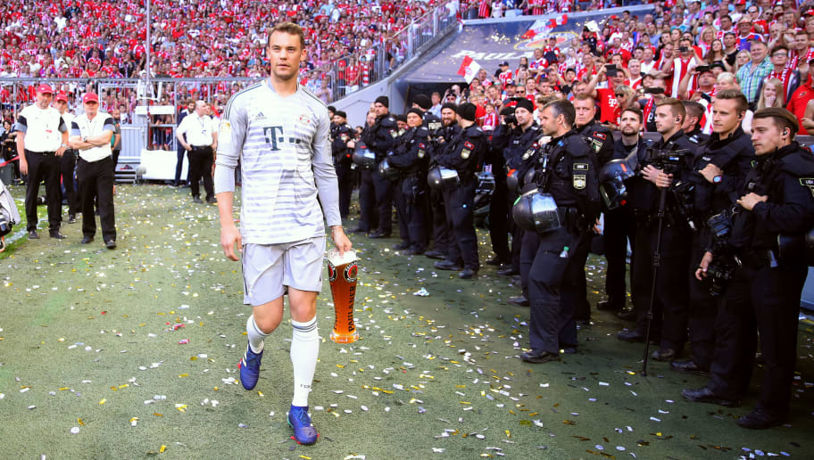 MUNICH, GERMANY - MAY 12:  Manuel Neuer of Bayern Muenchen celebrates winning the German Championship title after the Bundesliga match between FC Bayern Muenchen and VfB Stuttgart at Allianz Arena on May 12, 2018 in Munich, Germany.  (Photo by Alexander Hassenstein/Bongarts/Getty Images)