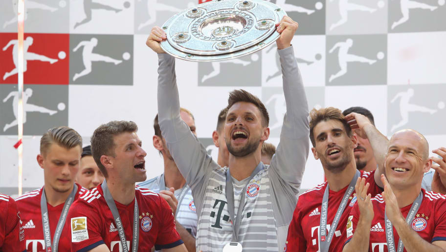 MUNICH, GERMANY - MAY 12:  Sven Ulreich of Bayern Muenchen lifts the trophy after the Bundesliga match between FC Bayern Muenchen and VfB Stuttgart at Allianz Arena on May 12, 2018 in Munich, Germany.  (Photo by Alexander Hassenstein/Bongarts/Getty Images)