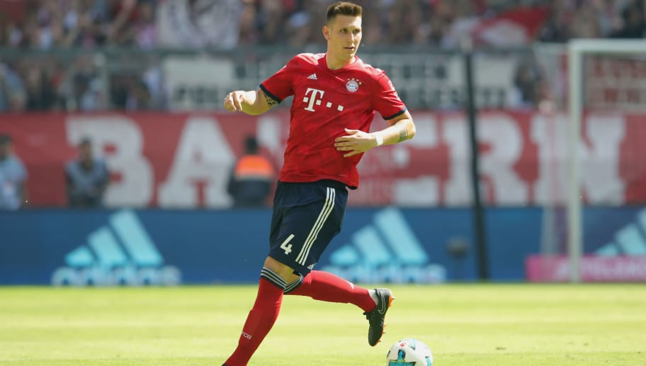 MUNICH, GERMANY - MAY 12:  Niklas Suele of FC Bayern Muenchen runs with the ball during the Bundesliga match between FC Bayern Muenchen and VfB Stuttgart at Allianz Arena on May 12, 2018 in Munich, Germany.  (Photo by Alexander Hassenstein/Bongarts/Getty Images)