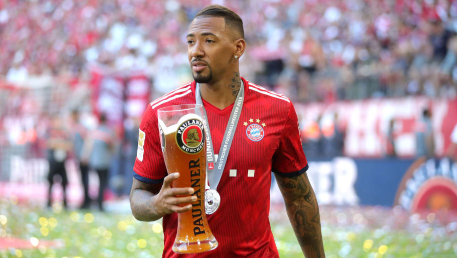 MUNICH, GERMANY - MAY 12:  Jerome Boateng of Bayern Muenchen is seen on the pitch with beer, after being presented with the Bundesliga trophy following the Bundesliga match between FC Bayern Muenchen and VfB Stuttgart at Allianz Arena on May 12, 2018 in Munich, Germany.  (Photo by Alexander Hassenstein/Bongarts/Getty Images)