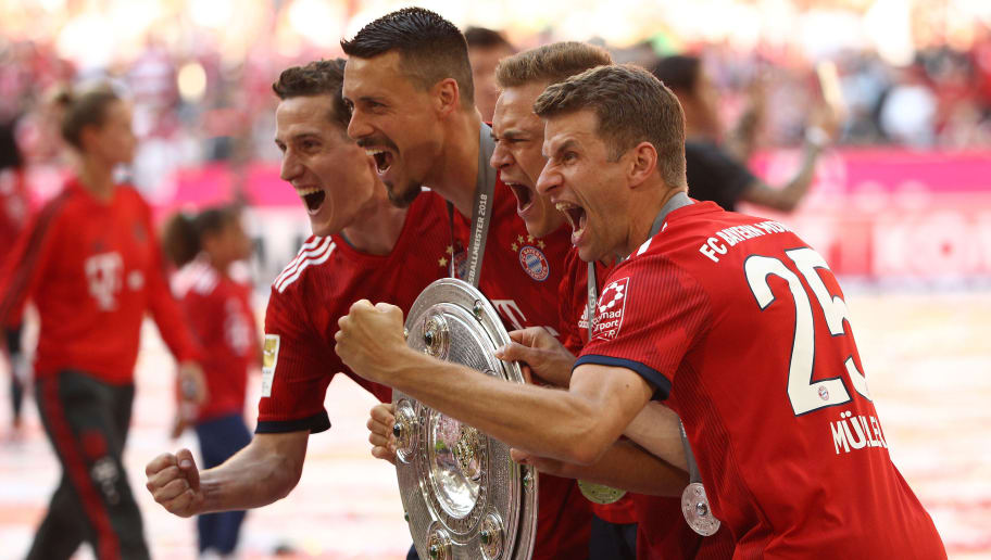 MUNICH, GERMANY - MAY 12: (L-R:) Sebastian Rudy, Sandro Wagner, Joshua Kimmich, Thomas Mueller of Bayern Muenchen pose with the champions trophy the Bundesliga match between FC Bayern Muenchen and VfB Stuttgart at Allianz Arena on May 12, 2018 in Munich, Germany. (Photo by Adam Pretty/Bongarts/Getty Images)