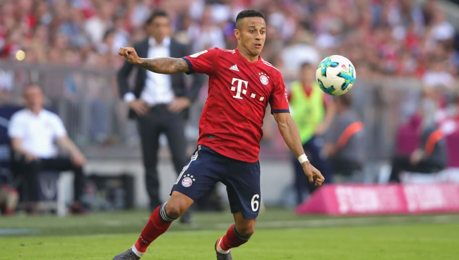 MUNICH, GERMANY - MAY 12:  Thiago Alcantara of FC Bayern Muenchen runs with the ball during the Bundesliga match between FC Bayern Muenchen and VfB Stuttgart at Allianz Arena on May 12, 2018 in Munich, Germany.  (Photo by Alexander Hassenstein/Bongarts/Getty Images)