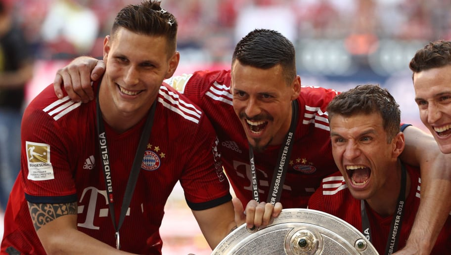 MUNICH, GERMANY - MAY 12: Niklas Suele, Sandro Wagner, Thomas Mueller, Sebastian Rudy of Muenchen pos with the champions trophy after the Bundesliga match between FC Bayern Muenchen and VfB Stuttgart at Allianz Arena on May 12, 2018 in Munich, Germany. (Photo by Adam Pretty/Bongarts/Getty Images)