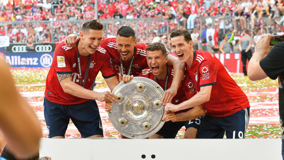 MUNICH, GERMANY - MAY 12: Niklas Suele of Muenchen, Sandro Wagner of Muenchen, Thomas Mueller of Muenchen and Sebastian Rudy of Muenchen celebrate winning the championship after the Bundesliga match between FC Bayern Muenchen and VfB Stuttgart at Allianz Arena on May 12, 2018 in Munich, Germany. (Photo by TF-Images/Getty Images)