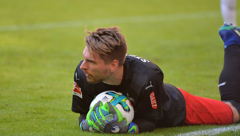 MUNICH, GERMANY - MAY 12: Goalkeeper Ron-Robert Zieler of Stuttgart on the ground during the Bundesliga match between FC Bayern Muenchen and VfB Stuttgart at Allianz Arena on May 12, 2018 in Munich, Germany. (Photo by TF-Images/Getty Images)