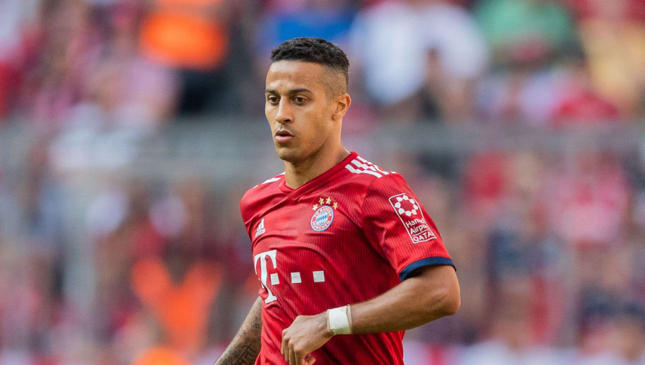 MUNICH, GERMANY - MAY 12: Thiago Alcantara of FC Bayern Muenchen runs with the ball during the Bundesliga match between FC Bayern Muenchen and VfB Stuttgart at Allianz Arena on May 12, 2018 in Munich, Germany. (Photo by Boris Streubel/Getty Images)