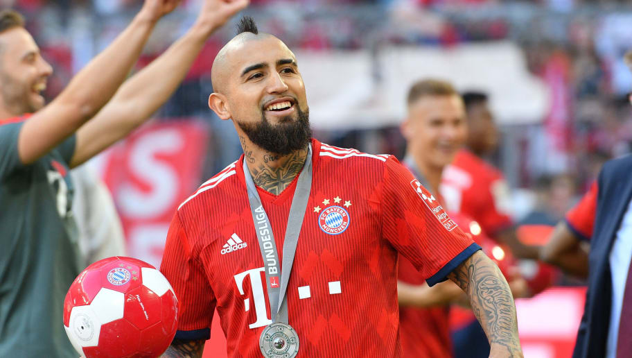 MUNICH, GERMANY - MAY 12: Arturo Vidal of Muenchen laughs after the Bundesliga match between FC Bayern Muenchen and VfB Stuttgart at Allianz Arena on May 12, 2018 in Munich, Germany. (Photo by TF-Images/Getty Images)
