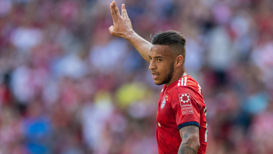 MUNICH, GERMANY - MAY 12: Corentin Tolisso of FC Bayern Muenchen celebrates after scoring his team's first goal during the Bundesliga match between FC Bayern Muenchen and VfB Stuttgart at Allianz Arena on May 12, 2018 in Munich, Germany. (Photo by Boris Streubel/Getty Images)
