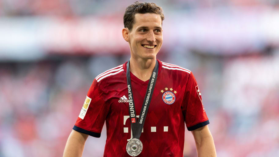 MUNICH, GERMANY - MAY 12: Sebastian Rudy of FC Bayern Muenchen celebrates the 28th German football championship after the Bundesliga match between FC Bayern Muenchen and VfB Stuttgart at Allianz Arena on May 12, 2018 in Munich, Germany. (Photo by Boris Streubel/Getty Images)
