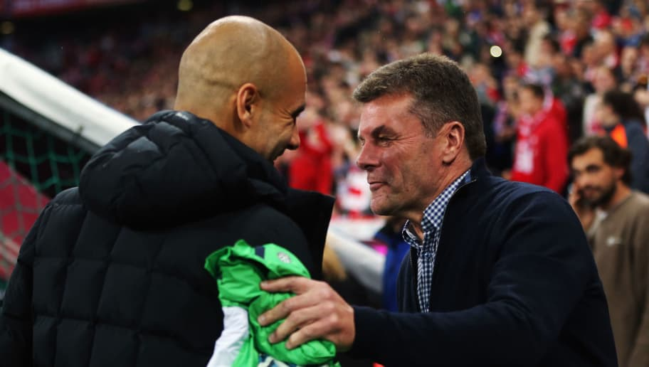 MUNICH, GERMANY - SEPTEMBER 22:  Head coaches Pep Guardiola (L) of Muenchen and Dieter Hecking of Wolfsburg shake hands prior to the Bundesliga match between FC Bayern Muenchen and VfL Wolfsburg at Allianz Arena on September 22, 2015 in Munich, Germany.  (Photo by Alex Grimm/Bongarts/Getty Images)