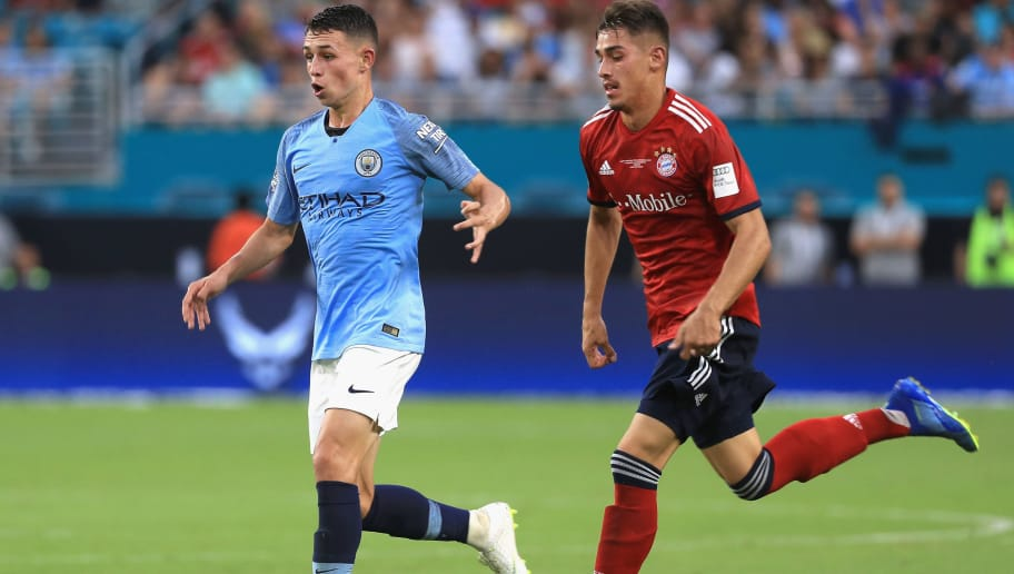 MIAMI, FL - JULY 28:  Aymeric Laporte #14 of Manchester City is chased by Meritan Shabani #47 of FC Bayern Munich during the first half of the International Champions Cup 2018 match at Hard Rock Stadium on July 28, 2018 in Miami, Florida.  (Photo by Mike Ehrmann/International Champions Cup/Getty Images)