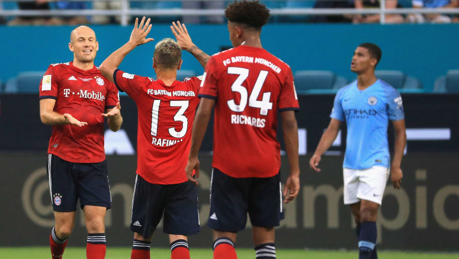 MIAMI, FL - JULY 28:  Arjen Robben #10 of FC Bayern Munich celebrates his goal with teammate Rafinha #13 during the first half of the International Champions Cup 2018 match against Manchester City at Hard Rock Stadium on July 28, 2018 in Miami, Florida.  (Photo by Mike Ehrmann/International Champions Cup/Getty Images)