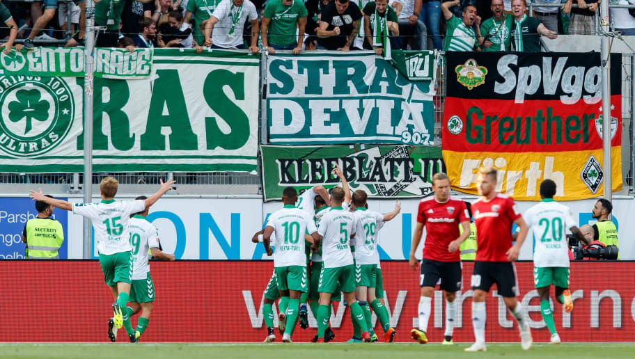 INGOLSTADT, GERMANY - AUGUST 10: Lukas Josef Gugganig of Greuther Fuerth celebrates after scoring his team`s first goal with team mates during the Second Bundesliga match between FC Ingolstadt 04 and SpVgg Greuther Fuerth at Audi Sportpark on August 10, 2018 in Ingolstadt, Germany. (Photo by TF-Images/Getty Images)