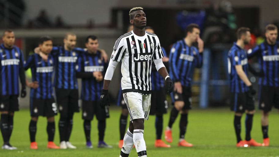 MILAN, ITALY - MARCH 02:  Paul Pogba of Juventus FC looks on during the TIM Cup match between FC Internazionale Milano and Juventus FC at Stadio Giuseppe Meazza on March 2, 2016 in Milan, Italy.  (Photo by Marco Luzzani/Getty Images)
