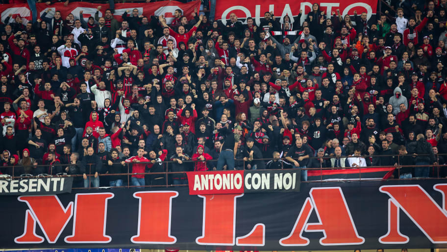 MILAN, ITALY - OCTOBER 21: Fans of AC Milan during the Serie A match between FC Internazionale and AC Milan at Stadio Giuseppe Meazza on October 21, 2018 in Milan, Italy. (Photo by Robbie Jay Barratt - AMA/Getty Images)