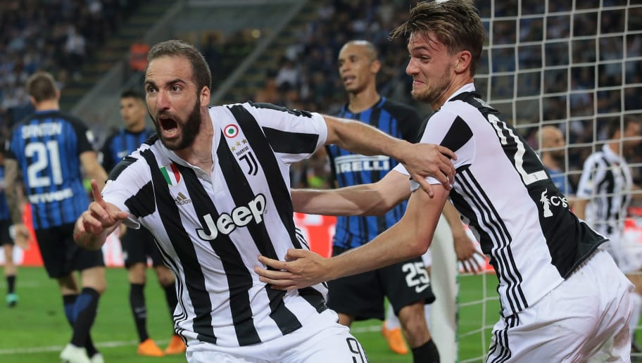 MILAN, ITALY - APRIL 28:  Gonzalo Higuain (L) of Juventus FC celebrates his goal with his team-mate Daniele Rugani during the serie A match between FC Internazionale and Juventus at Stadio Giuseppe Meazza on April 28, 2018 in Milan, Italy.  (Photo by Emilio Andreoli/Getty Images)