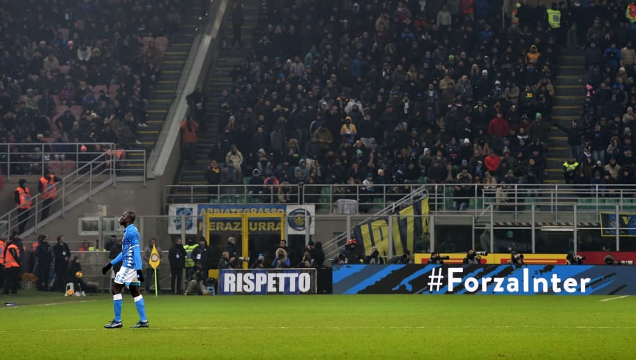 MILAN, ITALY - DECEMBER 26:  Kalidou Koulibaly of Napoli leaves the pitch after a red card during the Serie A match between FC Internazionale and SSC Napoli at Stadio Giuseppe Meazza on December 26, 2018 in Milan, Italy.  (Photo by Tullio Puglia/Getty Images)