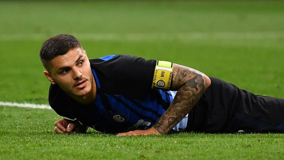 MILAN, ITALY - MAY 12:  Mauro Icardi of FC Internazionale looks dejcted during the Serie A match between FC Internazionale and US Sassuolo at Stadio Giuseppe Meazza on May 12, 2018 in Milan, Italy.  (Photo by Valerio Pennicino/Getty Images )