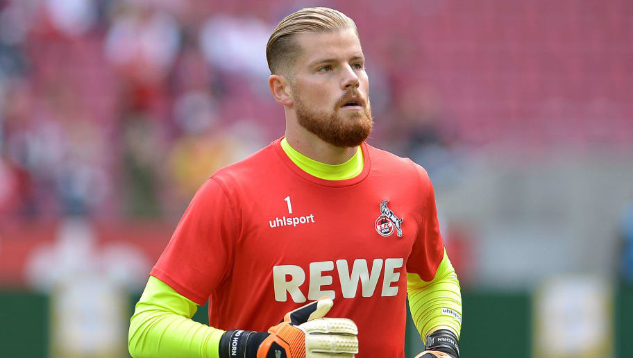 COLOGNE, GERMANY - AUGUST 25: Goalkeeper Timo Horn of FC Koeln controls the ball during the second Bundesliga match between FC Koeln and FC Erzgebirge Aue at RheinEnergieStadion on August 25, 2018 in Cologne, Germany. (Photo by TF-Images/Getty Images)