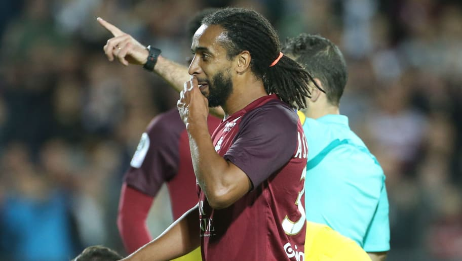 METZ, FRANCE - SEPTEMBER 8: Benoit Assou-Ekotto of FC Metz is sent off with a red card by referee Sebastien Desiage during the French Ligue 1 match between FC Metz and Paris Saint Germain (PSG) at Stade Saint-Symphorien on September 9, 2017 in Metz, France. (Photo by Jean Catuffe/Getty Images)