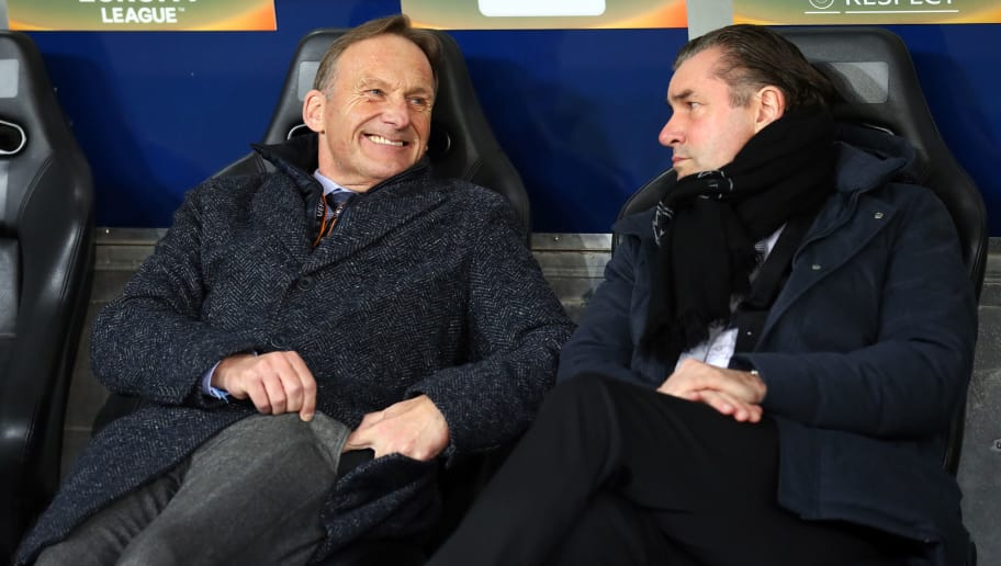 SALZBURG, AUSTRIA - MARCH 15: CEO Hans-Joachim Watzke of Dortmund laughs and Michael Zorc of Dortmund looks on prior to UEFA Europa League Round of 16 second leg match between FC Red Bull Salzburg and Borussia Dortmund at the Red Bull Arena on March 15, 2018 in Salzburg, Austria. (Photo by TF-Images/Getty Images)