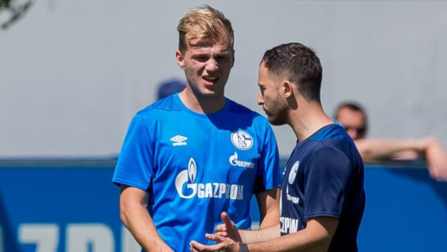 GELSENKIRCHEN, GERMANY - JULY 02: Head coach Domenico Tedesco of Schalke speaks with Johannes Geis of Schalke during a training session at the FC Schalke 04 Training center on July 2, 2018 in Gelsenkirchen, Germany. (Photo by TF-Images/Getty Images)