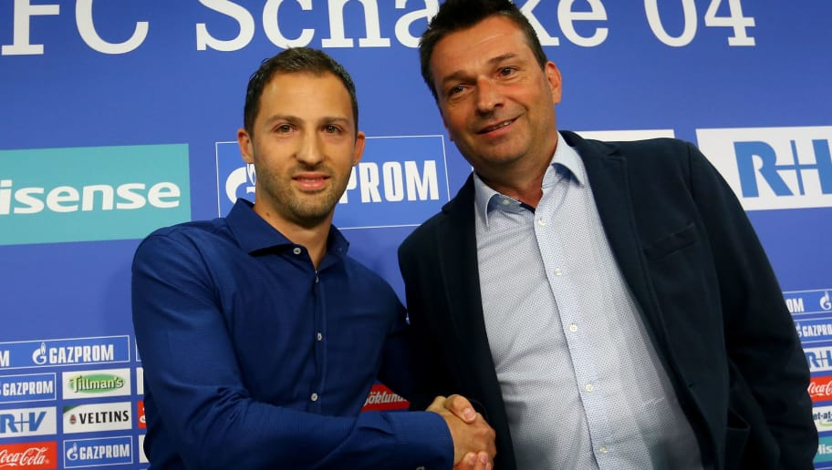 GELSENKIRCHEN, GERMANY - JUNE 21: (L-R) Head coach Domenico Tedesco and manager Christian Heidel of Schalke pose during the presentation of new head coach Domenico Tedesco at Veltins-Arena on June 21, 2017 in Gelsenkirchen, Germany.  (Photo by Christof Koepsel/Bongarts/Getty Images)